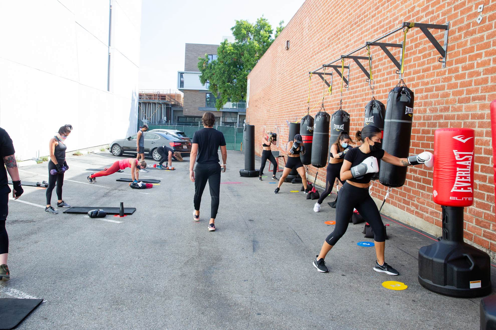 Lincoln Blvd. Santa Monica gym clients outside class hitting heavy bags