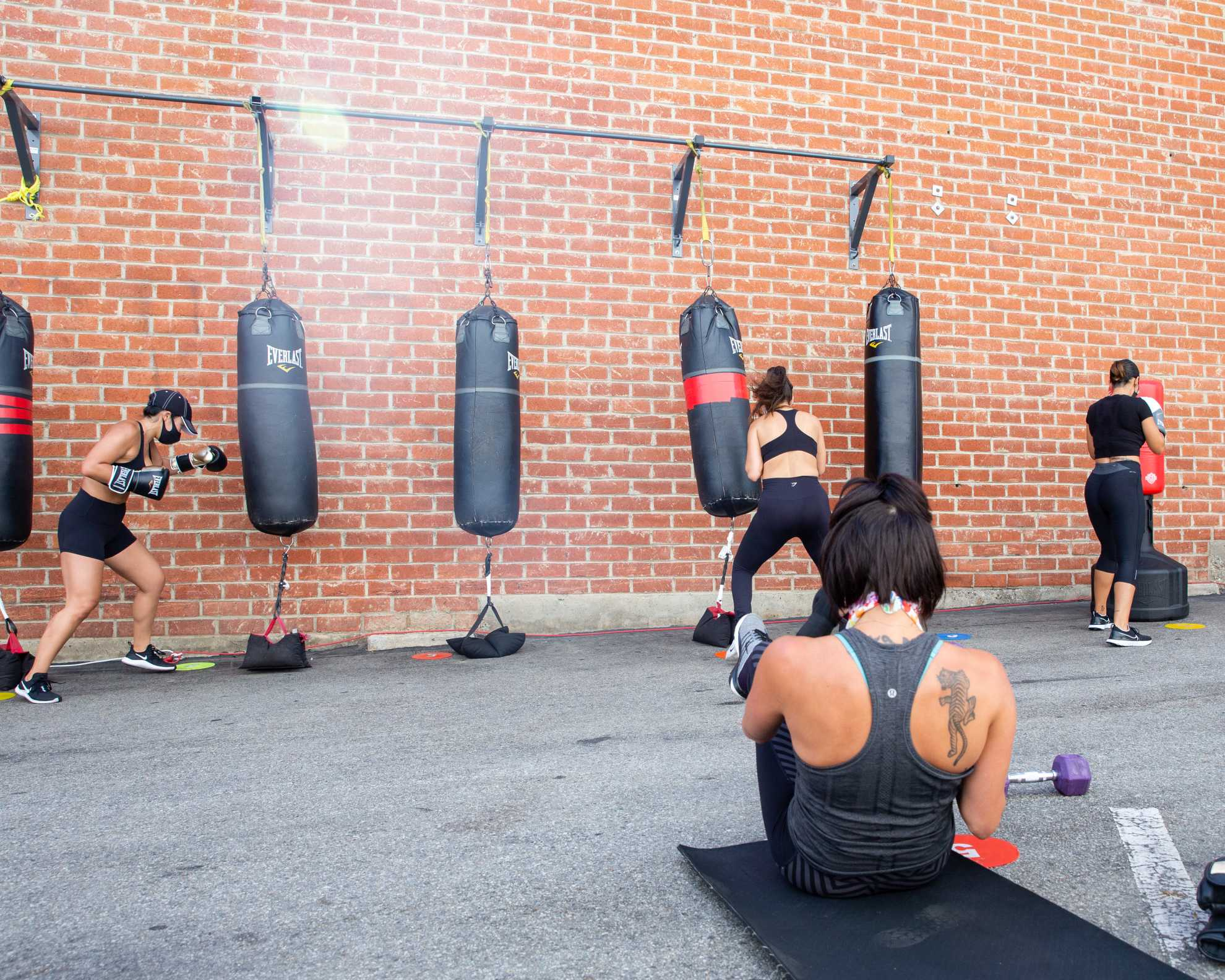 Lincoln Blvd. Santa Monica gym clients outside class boxing and training